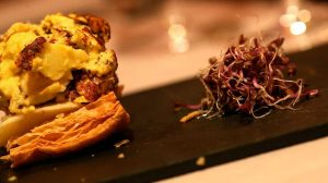 Puff pastry and chistorra with sprout of beet