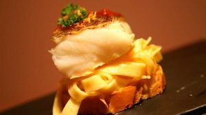 Hake with peppers and linguine